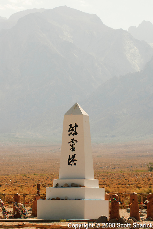 A California picture showing the monument at the Manzanar National Historic Site with the Sierra Nevada Mountains in the background.