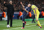 Paris Saint-Germain Marco Verratti pulls up with Paris Saint-Germain Manager Laurent Blanc looking on during the Champions League match between Paris Saint-Germain and Chelsea at Parc des Princes, Paris, France on 17 February 2015. Photo by Phil Duncan.