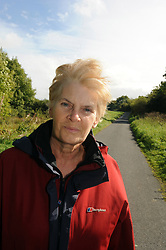 A woman in early retirement enjoys walking in the countryside. MODEL RELEASED