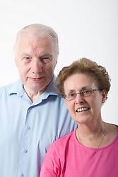 Portrait of an older couple smiling,