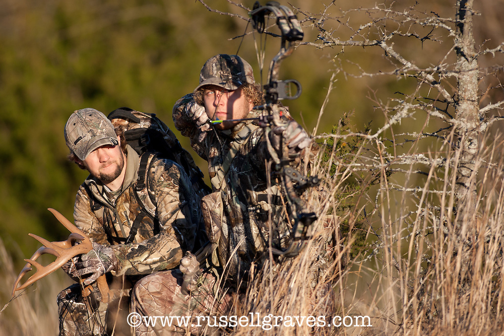 Bowhunters teaming up on a hunt.  One hunter shoots while the other rattles.