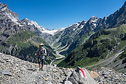 Kandersteg is a great base for hiking in Switzerland. For example: an epic hike from Selden in Bern canton traverses Lötsch glacier and Lötschen Pass (German: Lötschenpass, Swiss German: Lötschepass) to neighboring Lötschental in Valais canton; hiking poles recommended. The walk starts with a reserved Postbus ride from Kandersteg to Selden (in Gasterntal / Gasteretal / Gasterental), climbs 1350 meters, descends 925 m, and ends 13 km later at Lauchernalp lift station, which descends to Wiler in Lötschental, to reach Goppenstein via Postbus, back to Kandersteg via train. You can also reverse the route or stay overnight in dorms at Lötschepass hut. For licensing options, please inquire.