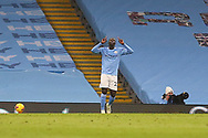GOAL 3-0 Manchester City defender Benjamin Mendy (22) scores a goal and celebrates during the Premier League match between Manchester City and Burnley at the Etihad Stadium, Manchester, England on 28 November 2020.