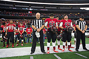 The Iraan High School football team take a moment of silence for Liz Pope during the state championship game at AT&T Stadium in Arlington, Texas on December 15, 2016. (Cooper Neill for The New York Times)