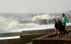 © Licensed to London News Pictures. 24/10/2011. Felixstowe, UK. A young family watch the waves. Windy weather along Felixstowe promenade today 24th October 2011. Parts of the UK are braced for wet and windy weather over the next 24hrs . Photo: Stephen Simpson/LNP