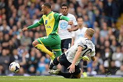 Norwich's Nathan Redmond is tackled by Tottenham's Michael Dawson   - Photo mandatory by-line: Mitchell Gunn/JMP - Tel: Mobile: 07966 386802 14/09/2013 - SPORT - FOOTBALL -  White Hart Lane - London - Tottenham Hotspur v Norwich - Barclays Premier League