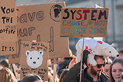 In Parliament Square - School students go on strike over the lack of action on climate change. They gather in Parliament square and march on Downing Street, blocking the streets around westminster for over an hour.
