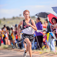 Many Farms Lobo Liyah Begay nears the finish in third place for the girls varsity race during the Rehoboth Invitational cross country meet in Rehoboth Friday. Begay finished with a time of 23:07.