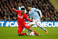 Daniel Sturridge of Liverpool (l) is fouled by David Silva of Manchester City. Capital One Cup Final, Liverpool v Manchester City at Wembley stadium in London, England on Sunday 28th Feb 2016. pic by Chris Stading, Andrew Orchard sports photography.