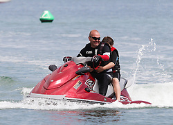 © Licensed to London News Pictures. 23/05/2015. St. Helens, UK. A man and boy on a jet ski enjoying the warm and sunny weather at The Duver beach in St. Helens on the Isle of Wight today, Friday 23rd May 2015. Today has been warm and sunny in the South of England. Photo credit : Rob Arnold/LNP