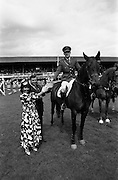 "06/08/1987<br /> 08/06/1987<br /> 06 August 1987<br /> RDS Horse Show, Ballsbridge, Dublin. The Jameson Whiskey International. Picture shows Comandant Gerry Mullins on ""Limerick"", winner of the  Jameson Whiskey International receiving the trophy from Marie Cummins and her husband Michael, Managing Director, Irish Distillers Sales Company."
