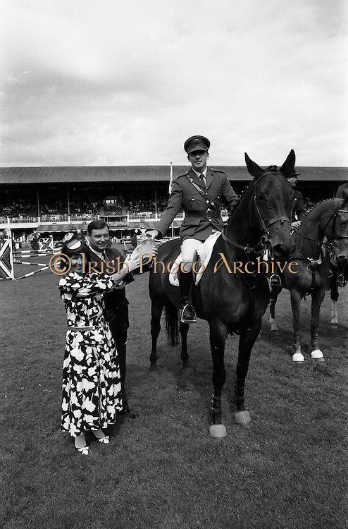 """06/08/1987<br /> 08/06/1987<br /> 06 August 1987<br /> RDS Horse Show, Ballsbridge, Dublin. The Jameson Whiskey International. Picture shows Comandant Gerry Mullins on """"Limerick"""", winner of the  Jameson Whiskey International receiving the trophy from Marie Cummins and her husband Michael, Managing Director, Irish Distillers Sales Company."""
