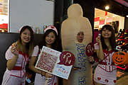 An organisation hands out free condoms and informs participants about safe sex during the hHalloween celebrations Shibuya, Tokyo, Japan. Saturday October 27th 2018. The celebrations marking this event have grown in popularity in Japan recently. Enjoyed mostly by young adults who like to dress up, drink , dance and misbehave in parts of Tokyo like Shibuya and Roppongi. There has been a push back from Japanese society and the police to try to limit the bad behaviour.