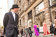 A man ogles the women as they walk by.