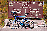 Bicycle and Red Mountain Pass sign on the San Juan Skyway (Highway 550), Uncompahgre National Forest, Colorado
