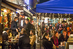 © Licensed to London News Pictures.12/12/2020. London, UK. Londoners making the most of Saturday night out in Soho, central London while London is at risk of moving to Tier 3 due to an increase in coronavirus cases. Photo credit: Marcin Nowak/LNP