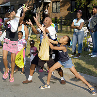 Parade goers scramble for candy during the Texas Southern University Homecoming parade, 10/15/05.  <br />   (Photo by Kim Christensen)