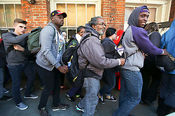 09 February 2016. New Orleans, Louisiana.<br /> Mardi Gras Day. Fearful students from an intolerant, fundamentalist Christian college hang onto each other for dear life as they are shepherded through the sinful French Quarter. <br /> Photo©; Charlie Varley/varleypix.com
