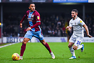 Funso Ojo of Scunthorpe United (6) looks up to pass under attention from Conor Chaplin of Coventry City (10) during the EFL Sky Bet League 1 match between Scunthorpe United and Coventry City at Glanford Park, Scunthorpe, England on 5 January 2019.