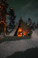 Aurora Borealis - Northern Lights over tent in Jukkasjärvi, Sweden