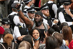 © Licensed to London News Pictures. 03/06/2020. London, UK. Protesters outside Downing St take part in a demonstration organised by group Black Lives Matter in Hyde Park for the American George Floyd who died whilst being arrested by US policemen Derek Chauvin. His death has caused civil unrest in some US cities. Photo credit: Ray Tang/LNP
