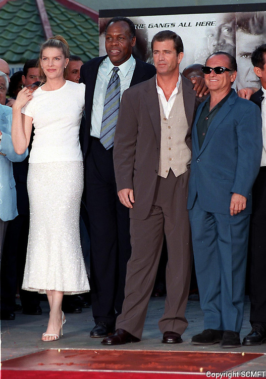 1998 Rene Russo, Mel Gibson and Joe Pesci join Danny Glover during his hand/footprint ceremony at Grauman's Chinese Theater