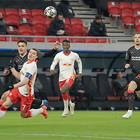 Marcel Sabitzer (front) of RB Leipzig and Ozan Kabak (back) of Liverpool FC fight for the ball during the UEFA Champions League Round of 16 First Leg Football match between RB Leipzig and Liverpool FC in Budapest, Hungary on Feb. 16, 2021. ATTILA VOLGYI