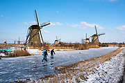 Icescaters in a winterlandscape, South of Holland, Netherlands