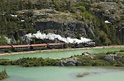 Alaska, White Pass and Yukon scenic Railroad passes by Summit Lake