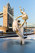 A frozen and snow covered fountain in front of Tower Bridge in London, England on February 28th, 2018. Freezing weather conditions dubbed the Beast from the East have brought snow and sub-zero temperatures to the UK.