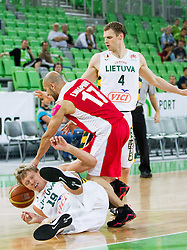 Mindaugas Kuzminskas of Lithuania vs Erfan Nasaj Pour of Iran during friendly basketball match between National Teams of Lithuania and Iran at Day 2 of Telemach Tournament on August 22, 2014 in Arena Stozice, Ljubljana, Slovenia. Photo by Vid Ponikvar / Sportida