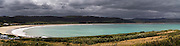 Panoramic view of an incoming storm threatens Porpoise Bay, near Waikawa, Clutha, New Zealand