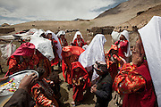 Kyrgyz women offering a  prayer, during a wedding celebration in the Afghan Pamir - camp of Kitshiq Aq Jyrga...Trekking through the high altitude plateau of the Little Pamir mountains (average 4200 meters) , where the Afghan Kyrgyz community live all year, on the borders of China, Tajikistan and Pakistan.