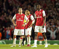 Photo: Olly Greenwood.<br />Arsenal v PSV Eindhoven. UEFA Champions League. Last 16, 2nd Leg. 07/03/2007. Arsenal's Cesc Fabregas, Denilson and Emmanuel Adebayor look dejected