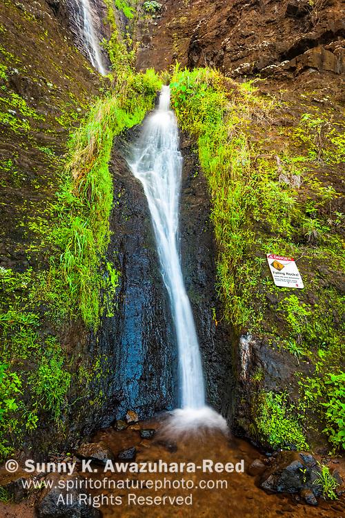 The waterfalls and pool at Kalalau Beach near Kalalau Campground, Na Pali Coast State Park, Kauai, Hawaii. Vertical image.