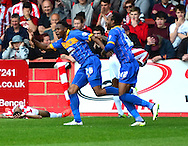Jean-Louis Akpa Akpro celebrates scoring the first goal during the Sky Bet League 2 match between Cheltenham Town and Shrewsbury Town at Whaddon Road, Cheltenham, England on 25 April 2015. Photo by Alan Franklin.