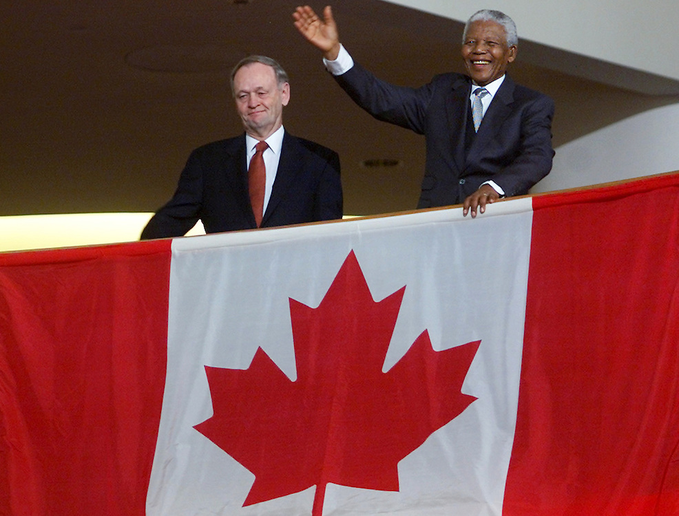 Former South African president Nelson Mandela (R) and Canadian Prime<br /> Minister Jean Chretien stand in front of the Canadian flag after<br /> Mandela was made an honorary Canadian citizen in Hull, November 19,<br /> 2001. Mandela, who was jailed for 27 years by South Africa's apartheid<br /> rulers, is only the second foreigner to receive the distinction.<br /> REUTERS/Jim Young