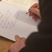 An tUachtaran Cumann Luthchleas Gael, Mr. Liam O'Neill, signs the guest book, during his visit to the Kilmurry Ibrickane GAA Club Centenary Closing Ceremony