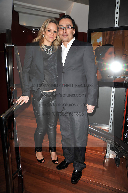 MARIE GUERLAIN and her husband SHANE DESAI at a party to view jewellery by Adler and paintings by Marie Guerlain held at Adler, 13 New Bond Street, London W1 on 9th February 2011.