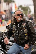 A bearded biker on Main Street during the 74th Annual Daytona Bike Week March 7, 2015 in Daytona Beach, Florida.