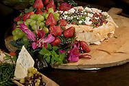 KEVIN BARTRAM/The Daily News.Galveston caterer Jim Manning prepared artichoke cheesecake, along with other dishes appropriate for an Academy Awards party, at his home in Galveston on Wednesday, Feb. 22, 2006.