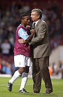 Photo. Glyn Thomas<br />West Ham Utd v Bradford City. Nationwide Division 1.<br />Upton Park, West Ham, London. 26/08/2003.<br />Trevor Brooking congratulates his team's goal scorer Jermaine Defoe after his side's 1-0 victory.