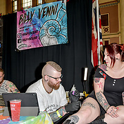 Billy Venni tattoo a client at The Great British Tattoo Show, on 26 May 2019, London, UK.