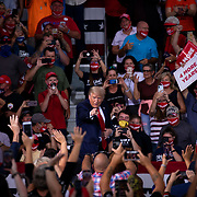 WINSTON-SALEM, NC - SEPT 8: President Donald Trump arrives to speak to a large group of supporters at a rally during a planned campaign stop right off the tarmac at Smith Reynolds Regional Airport in Winston-Salem, NC on September 8, 2020. North Carolina will be a battle ground state in the 2020 presidential election.  (Photo by Logan Cyrus for Bloomberg)