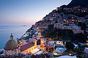 Dusk falls over Positano and the Li Galli Islands on the Amalfi Coast, Campagna, Italy, as seen from Le Sirenuse Hotel.
