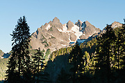 Three Fingers Mountain (6854 feet) and Queest-Alb Glacier are seen from a hike in Boulder River Wilderness on Goat Flats Trail #641 from Tupso Pass trailhead to Tin Can Gap. Mount Baker Snoqualmie National Forest, Washington, USA.