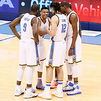 08 May 2016: Oklahoma City Thunder guard Russell Westbrook (0) talks to Oklahoma City Thunder forward Serge Ibaka (9), Oklahoma City Thunder center Steven Adams (12), Oklahoma City Thunder forward Kevin Durant (35) and Oklahoma City Thunder guard Dion Waiters (3) during the Oklahoma City Thunder 111-97 victory over the San Antonio Spurs, during Game Four of the Western Conference Semifinals of the NBA Playoffs at the Chesapeake Energy Arena, Oklahoma City, Oklahoma, USA.