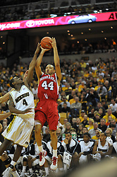 Jan 23, 2010; Columbia, MO, USA; Nebraska Cornhuskers guard Ryan Anderson (44) goes up for a shot as Missouri Tigers guard J.T. Tiller (4) attemtps to block in the first half at Mizzou Arena in Columbia, MO. Missouri won 70-53. Mandatory Credit: Denny Medley-US PRESSWIRE