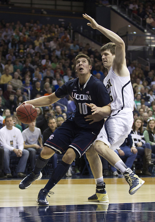 January 12, 2013:  Connecticut forward Tyler Olander (10) goes up for a shot as Notre Dame forward Jack Cooley (45) defends during NCAA Basketball game action between the Notre Dame Fighting Irish and the Connecticut Huskies at Purcell Pavilion at the Joyce Center in South Bend, Indiana.  Connecticut defeated Notre Dame 65-58.