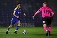 AFC Wimbledon defender Will Nightingale (5) battles for possession with Peterborough United defender Frazer Blake-Tracy (18) during the EFL Sky Bet League 1 match between AFC Wimbledon and Peterborough United at Plough Lane, London, United Kingdom on 2 December 2020.